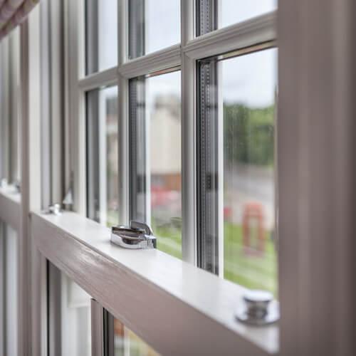 Close up of vertical sliding window locks