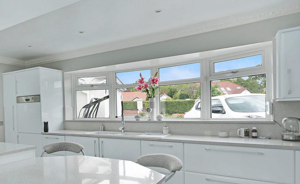 White triple glazed casement windows