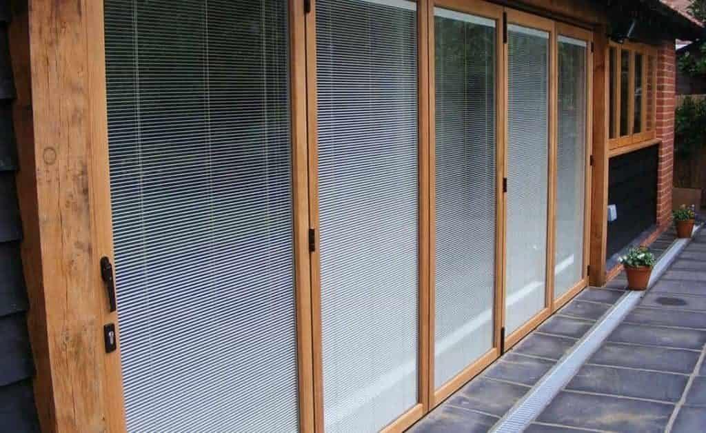 Oak effect bifold door with integral blinds