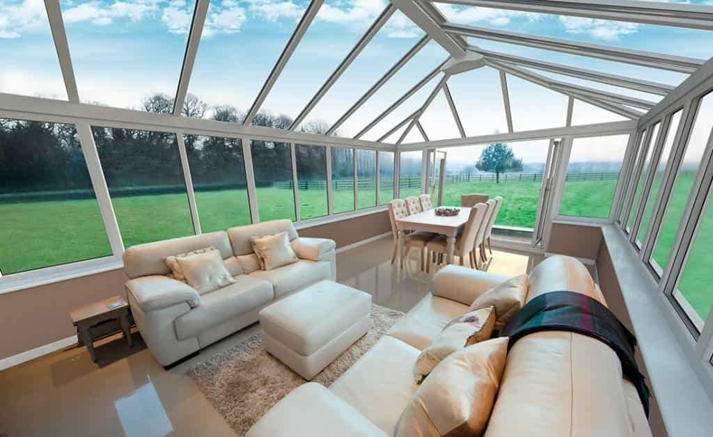 White uPVC Georgian conservatory with glass roof