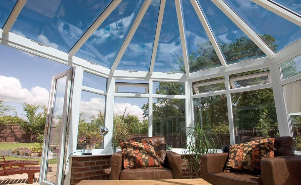 Interior of a Victorian conservatory with a glass roof