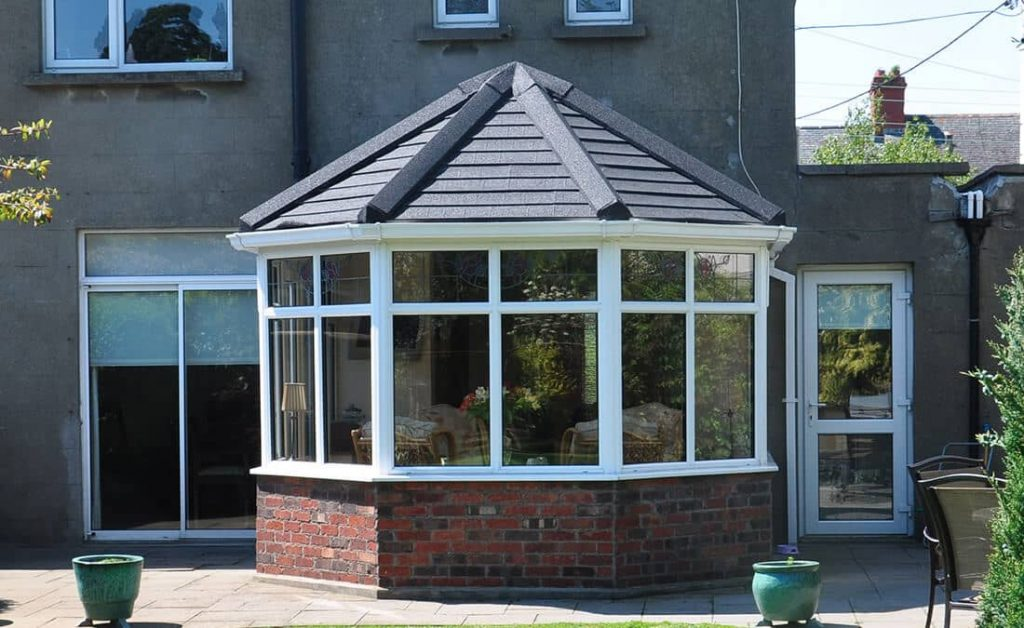Victorian conservatory with a grey tiled roof